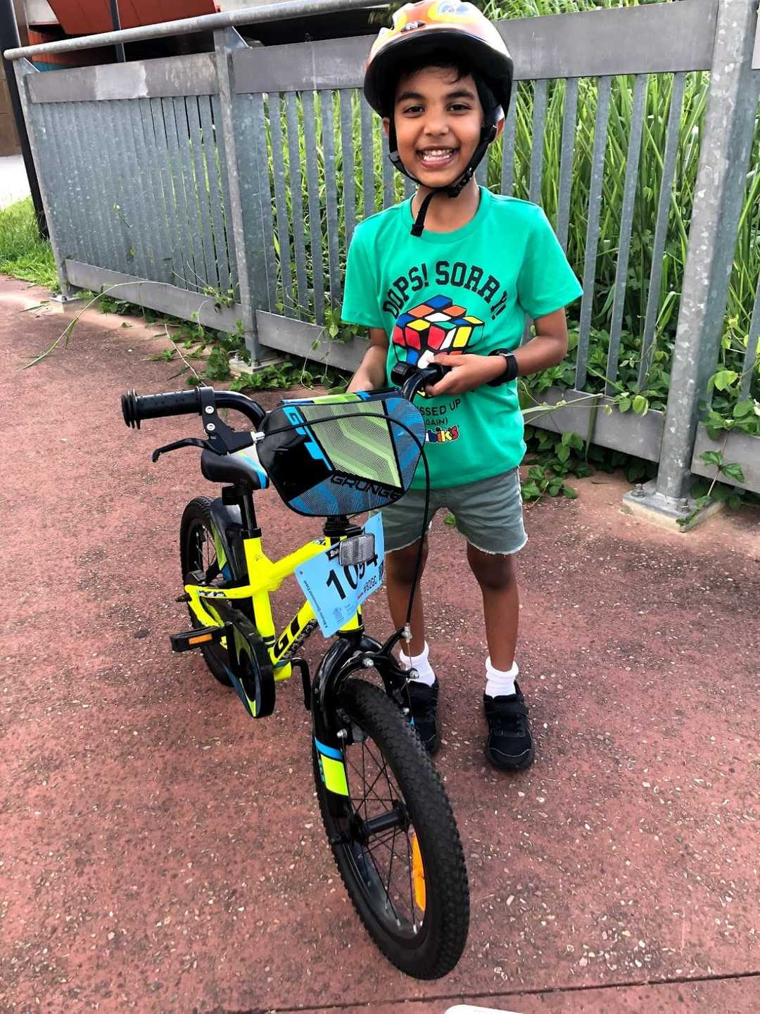 Gautham with his cycle, happy that he can ride on his own